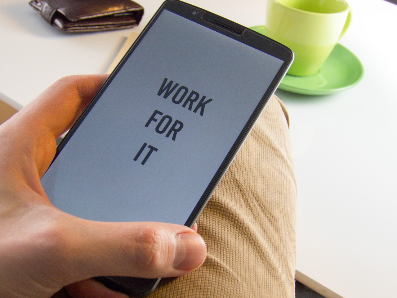 "Phone screen with the text: ""Work for it!"""