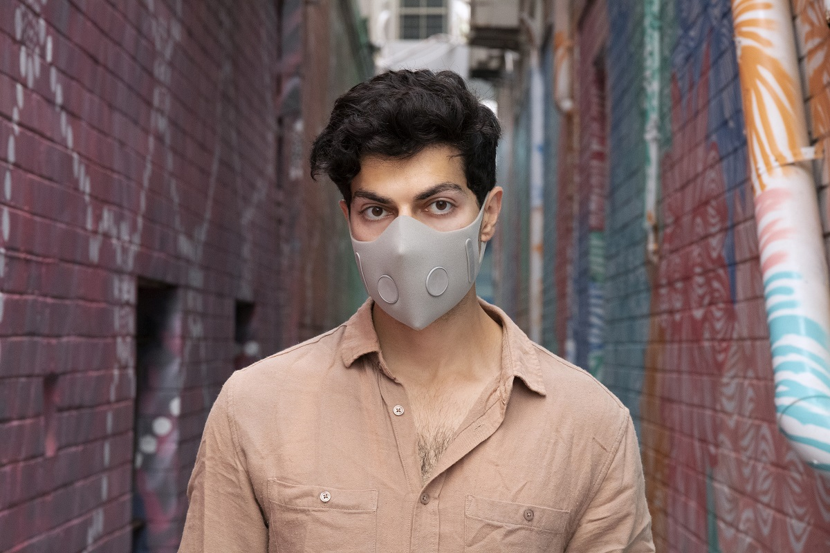 Man wearing AirAus masks in Light Grey with two exhale valves. Image courtesy: AirAus